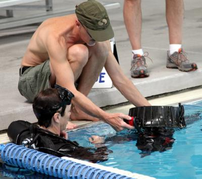 Trigger controls are explained for one of the test divers.